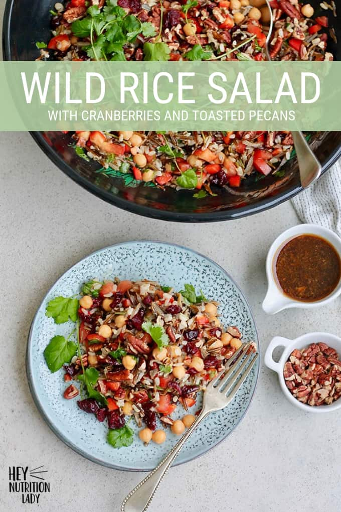 This Wild Rice Salad features chickpeas, cranberries, and toasted pecans. Tossed with a honey-sweetened sesame ginger dressing, and topped with lots of cilantro, this is an easy, healthy recipe. #wildricesalad #vegetarian