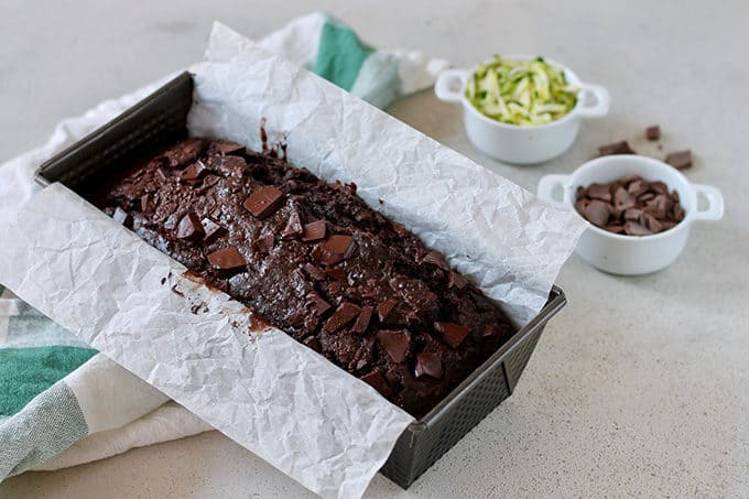 double chocolate zucchini loaf in a parchment-lined tin