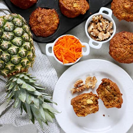 carrot pineapple muffins on a grey background