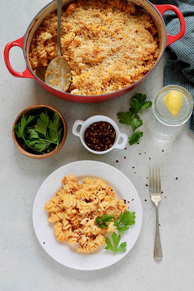 overhead photo of pumpkin mac and cheese in a red casserole dish