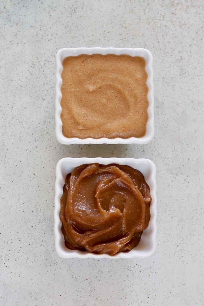 unsweetened applesauce and instant pot apple butter on a grey background