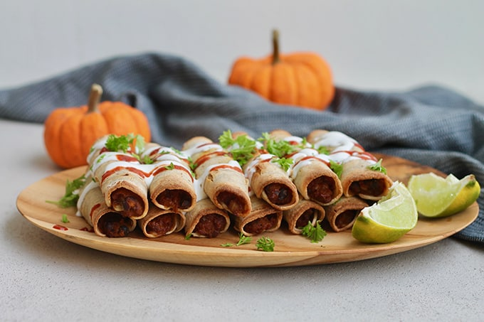platter of pumpkin and black bean taquitos from the side