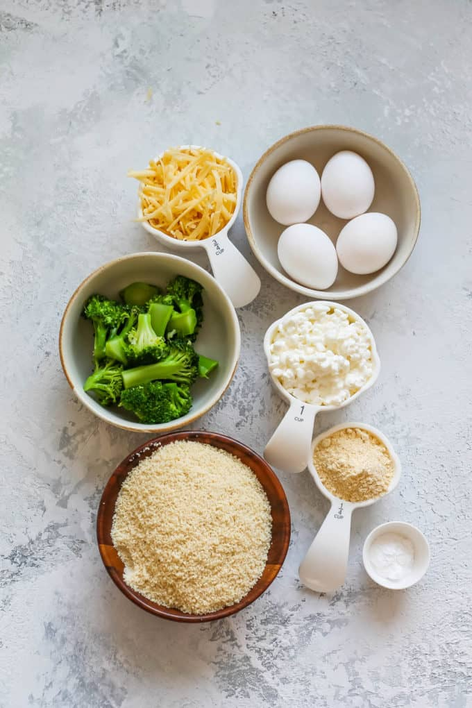 eggs, cheese, broccoli, almond flour, chickpea flour, baking soda, and cottage cheese on a white background