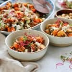 roasted butternut squash salad with lentils in two ceramic bowls