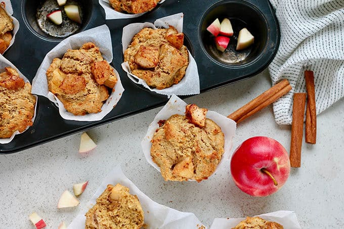 whole wheat muffins with cinnamon roasted apples on a grey background