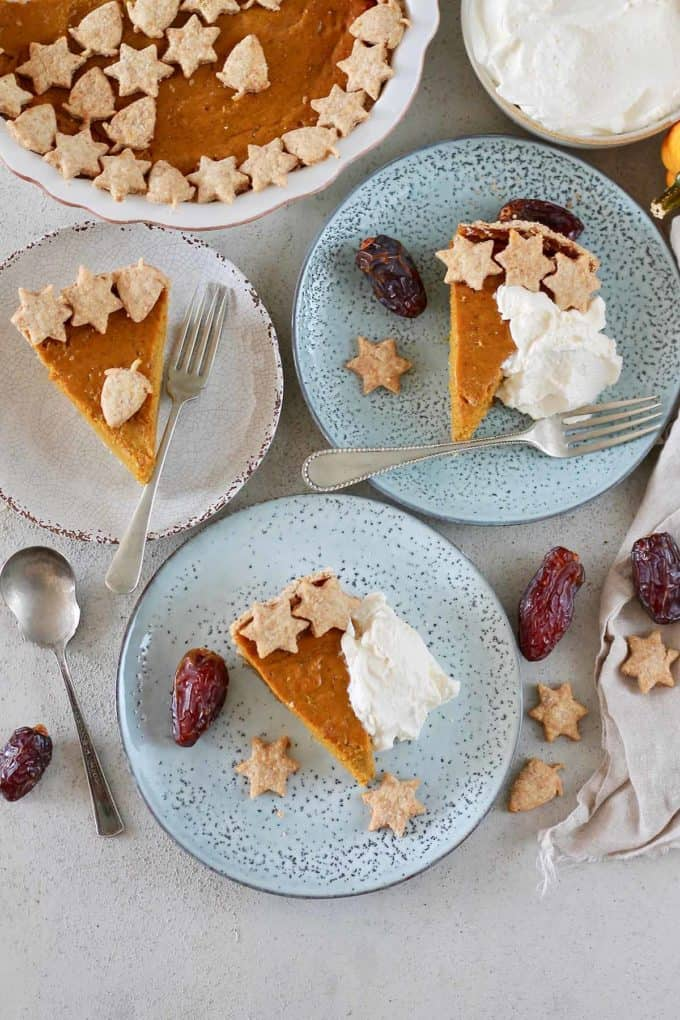 three slices of naturally sweetened pumpkin pie on blue plates