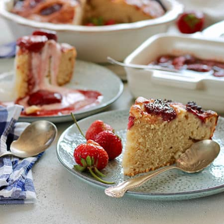 strawberry yogurt cake with strawberry sauce on blue plates