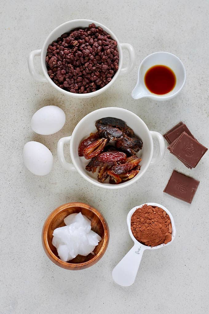 adzuki beans, dates, coconut oil, eggs, vanilla, cocoa, and chocolate on a grey surface