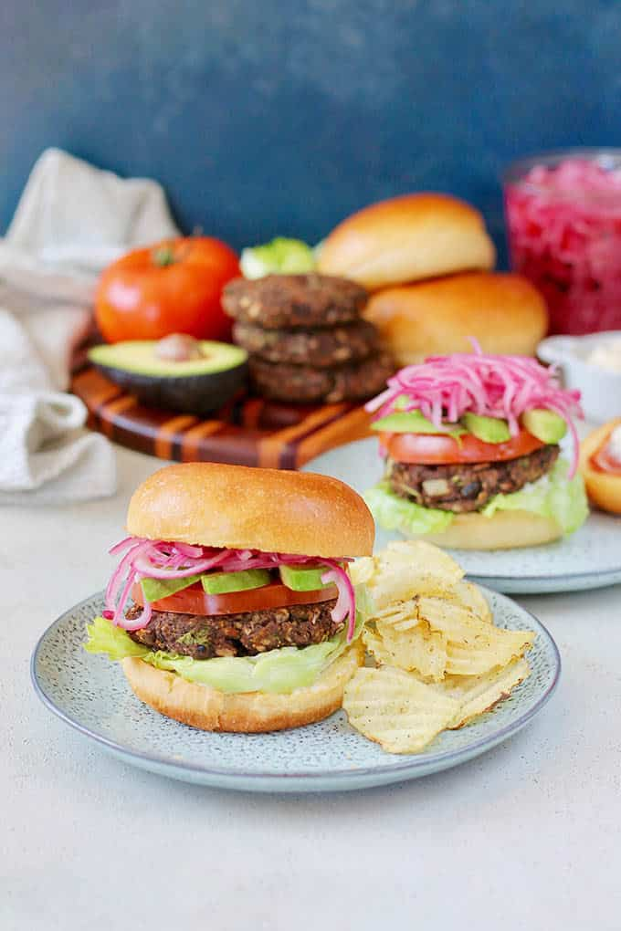 Chipotle black bean burgers on a blue plate
