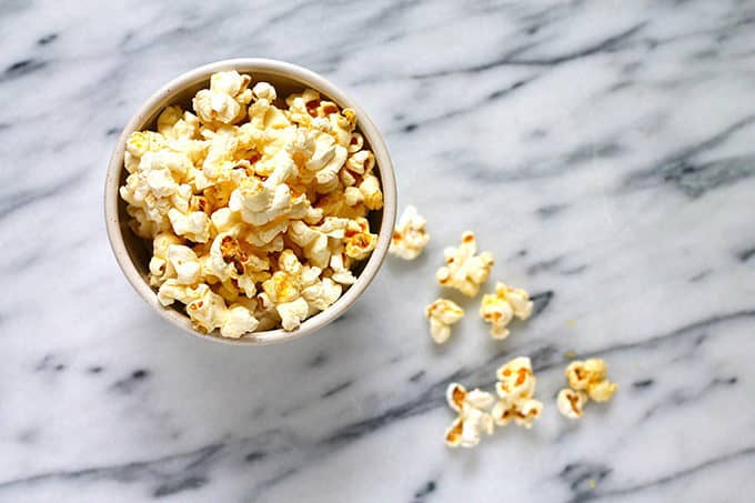 A bowl of popcorn on a marble background