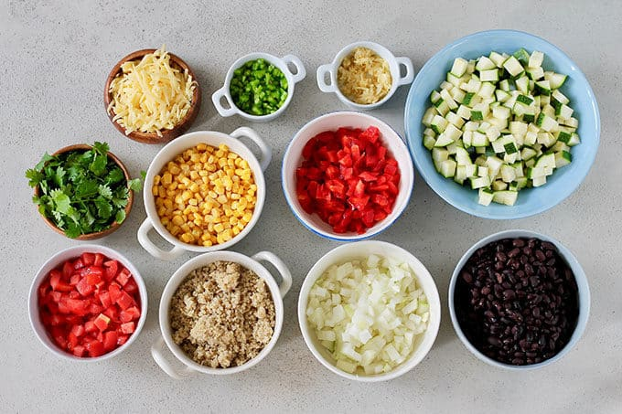 diced vegetables for making vegetarian burritos on a grey background