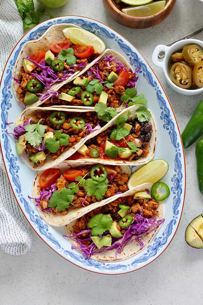 tempeh tacos with red cabbage and jalapenos on top
