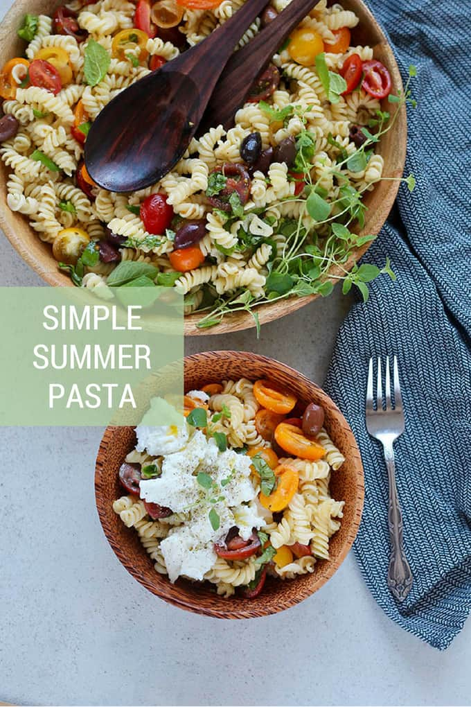 Simple Summer Pasta for hot summer days! This pasta is tossed with crushed tomatoes, herbs, and olives, with a drizzle of olive oil and some vinegar to brighten things up. It couldn't be easier to make or more delicious to eat. #pasta #summer #vegan #tomatoes #vegetarian #recipe #easy #healthy