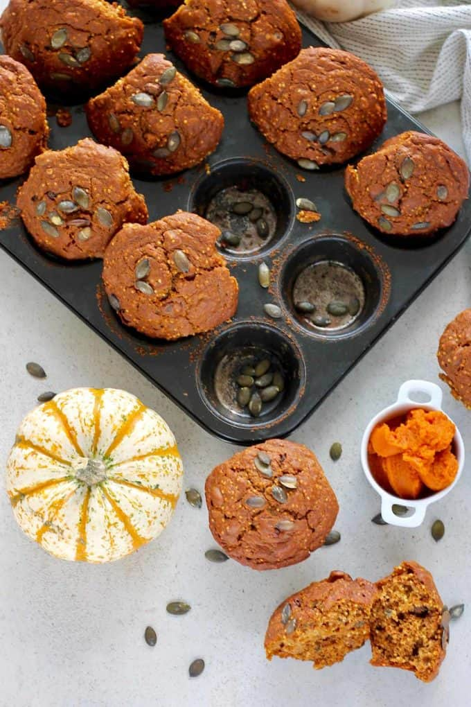 overhead photo of pumpkin muffins popped out of a muffin tin