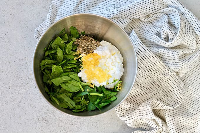 ricotta, spinach, and lemon zest in a metal bowl