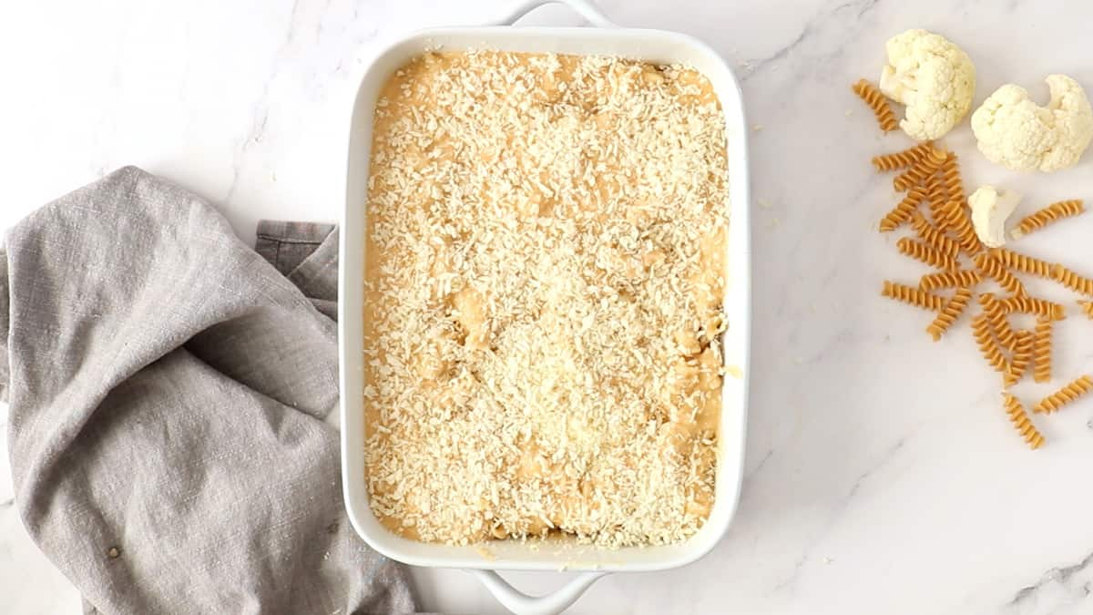 cheesy cauliflower pasta bake topped with panko bread crumbs and ready to go into the oven