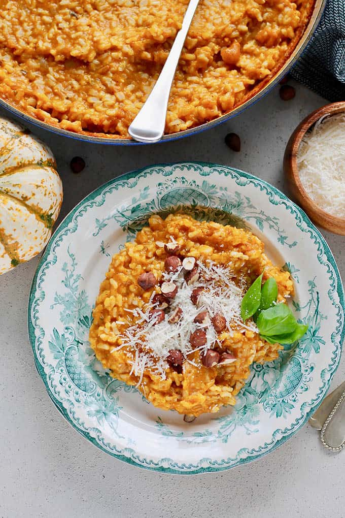Baked pumpkin risotto on a blue and white plate