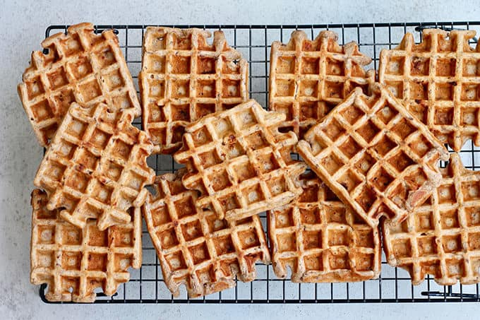 Overhead photo of vegan banana waffles on a cooling rack.