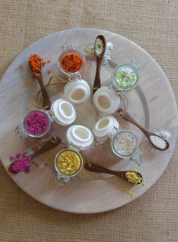 overhead photo of different flavoured salts on a grey plate