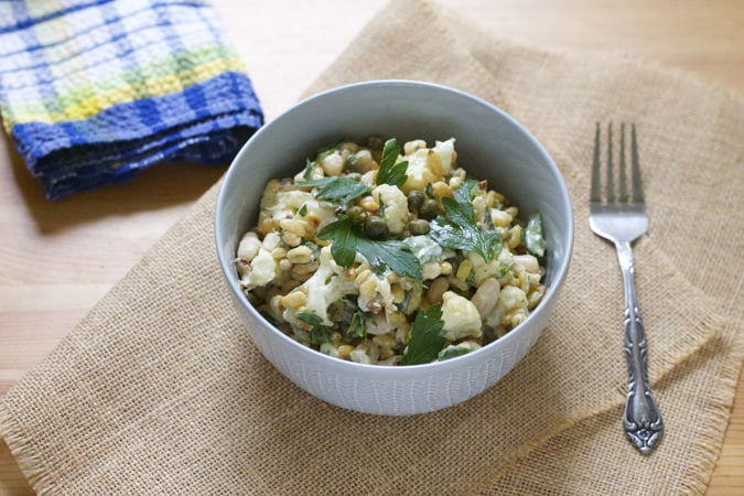 roasted cauliflower and white bean salad with lemony tahini sauce, capers, and toasted pine nuts // www.heynutritionlady.com