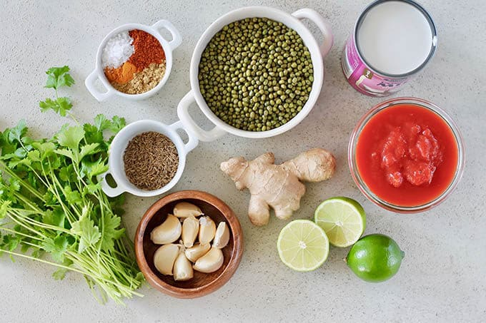 cilantro, spices, garlic, mung beans, ginger, tomato, coconut, and limes