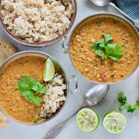 mung bean and coconut curry on a grey background
