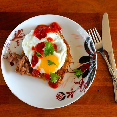 Toast for dinner! refried beans, crispy fried egg, salsa, and cilantro. Perfect for Cinco de Mayo! // www.heynutritionlady.com