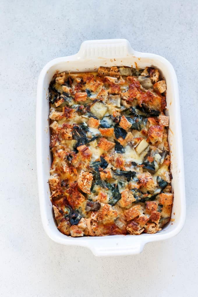 overhead photo of a vegetarian breakfast casserole in a white casserole dish