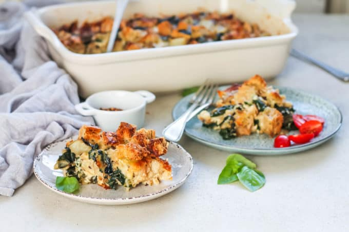 vegetarian breakfast casserole strata with swiss chard on a blue plate