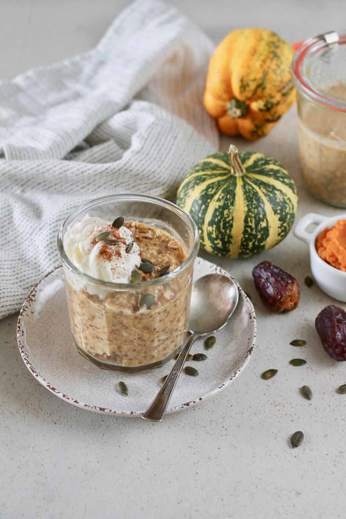 a jar of pumpkin overnight oats on a white plate