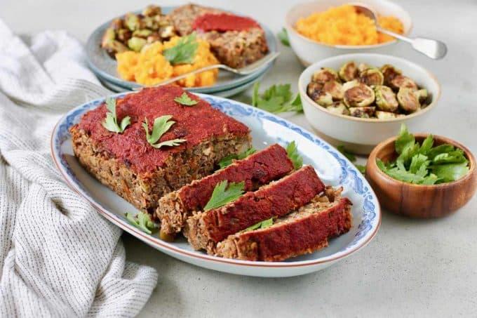 sliced vegan lentil loaf on a blue platter