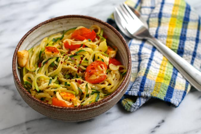 warm zucchini noodles with tomatoes and halloumi