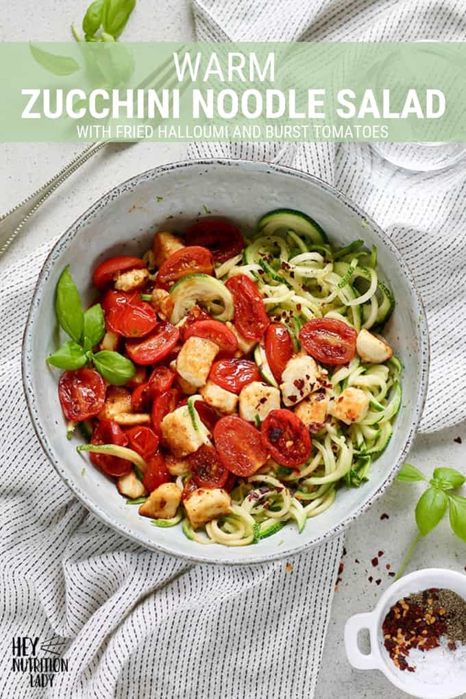 This Warm Zucchini Noodle Salad with fried halloumi and burst tomatoes is a delicious, low-carb, and healthy alternative to a traditional pasta dish. It's quick and easy to make, naturally gluten-free, and a great way to get in extra veggies! #recipe #vegetarian #zucchini #zucchininoodles #warm #lowcarb #glutenfree #easy #healthy #halloumi #cheese