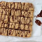 peanut butter oat bars sliced and drizzled with dark chocolate