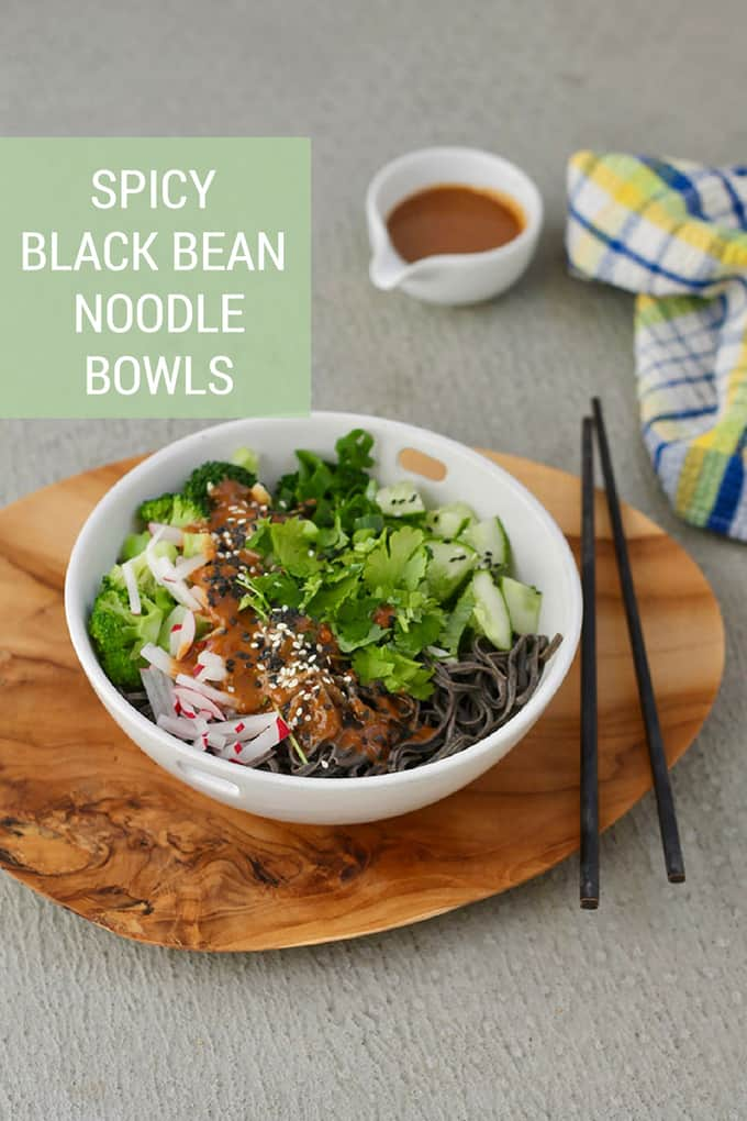 Spicy Black Bean Noodle Bowls! Protein-packed black bean noodles are tossed with a zippy sesame peanut sauce and fresh seasonal vegetables for a delicious plant-based meal. Perfect for packed lunches or make-ahead dinners. #vegan #glutenfree #beans #beanpasta #plantbased #vegetarian #quick #recipe #healthy #asian #noodles
