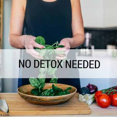 image of a woman tossing spinach leaves into a bowl with text that reads no detox needed
