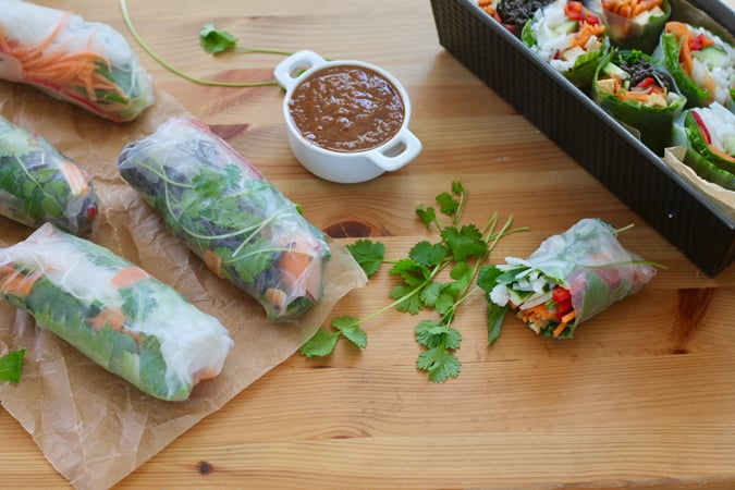 fresh and crisp summer salad rolls filled with veggies, baked tofu, and either black bean or rice noodles, and dunked in a zippy almond sauce you're sure to love // themuffinmyth.com