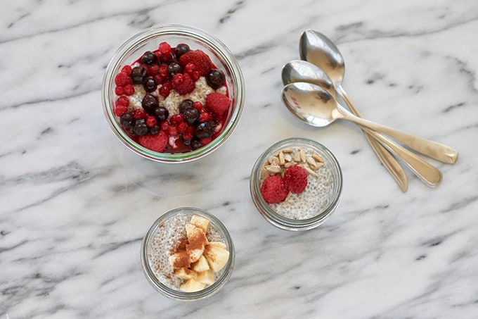 jars of chia pudding on a marble background