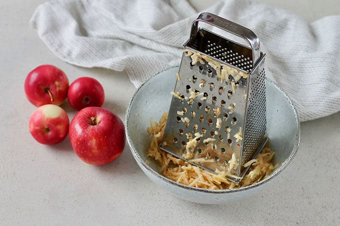 Grated apple in a blue bowl