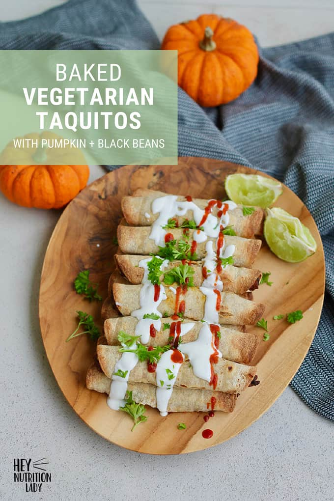 These baked vegetarian taquitos are made with pumpkin, black beans, and a bit of cheese. It's an easy, healthy recipe, and is totally freezer-friendly too!  #taquitos #vegetarian