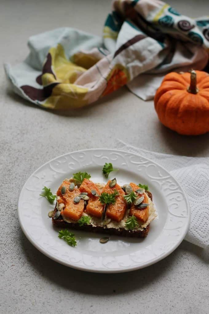 Roasted butternut squash and hummus on rye toast // www.heynutritionlady.com