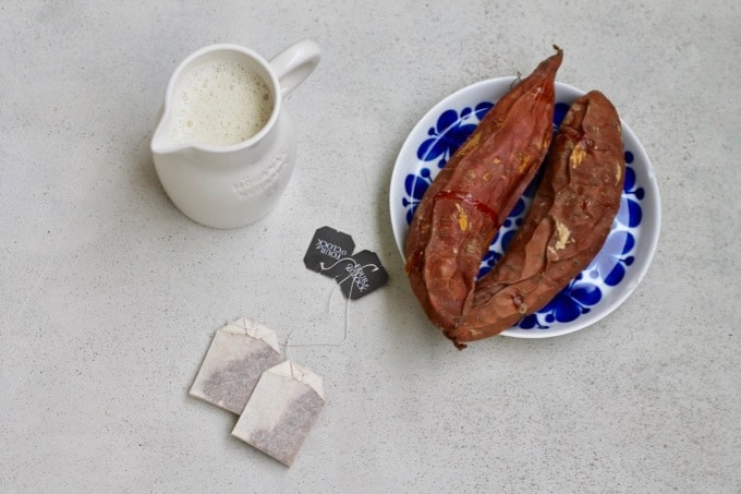 pitcher of oat milk, tea bags, and roasted sweet potatoes