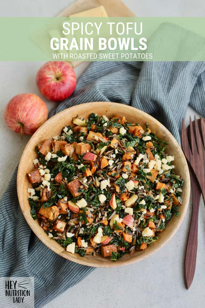 These Spicy Tofu Grain Bowls are a healthy vegetarian option that's easy to fit in your meal prep plan. Made with wild rice, roasted sweet potatoes, and kale, plus a game-changing tofu technique that doesn't require any pressing! These grain bowls are great to serve as a main dish, side dish, or even for packed lunch. #vegetarian #wildrice #glutenfree #grainbowl #salad #healthy #easy #mealprep #sweetpotato #kale #tofu #spicy #lunch