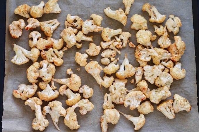 tray of seasoned cauliflower ready to be roasted