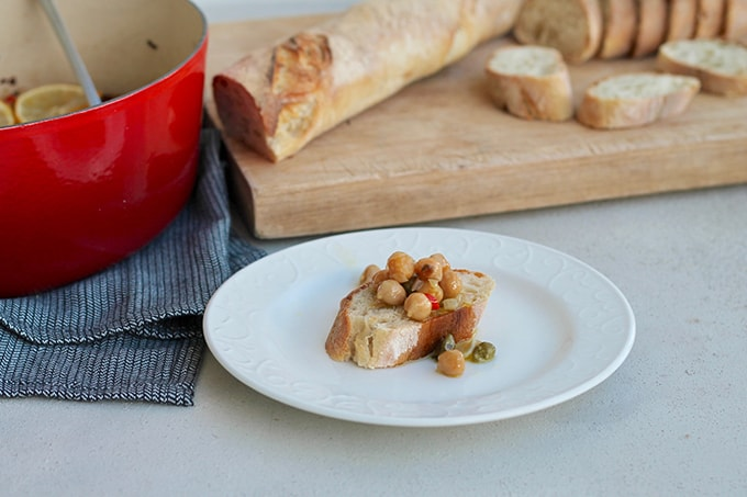 braised chickpeas on a piece of baguette
