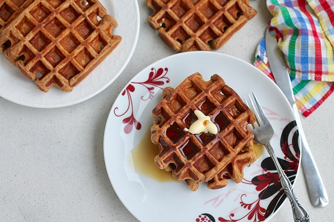 overhead photo of sweet potato gingerbread waffles on a white plate