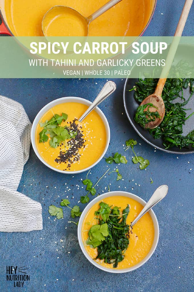 This Spicy Carrot Soup with Tahini and Garlicky Greens is so creamy and delicious you won't believe it's healthy! This recipe is easy to make, and is totally vegan, paleo, and Whole 30 compliant. It's a simple recipe your family will love! #soup #recipe #carrot #tahini #vegan #easy #healthy #whole30 #paleo #plantbased #spicy