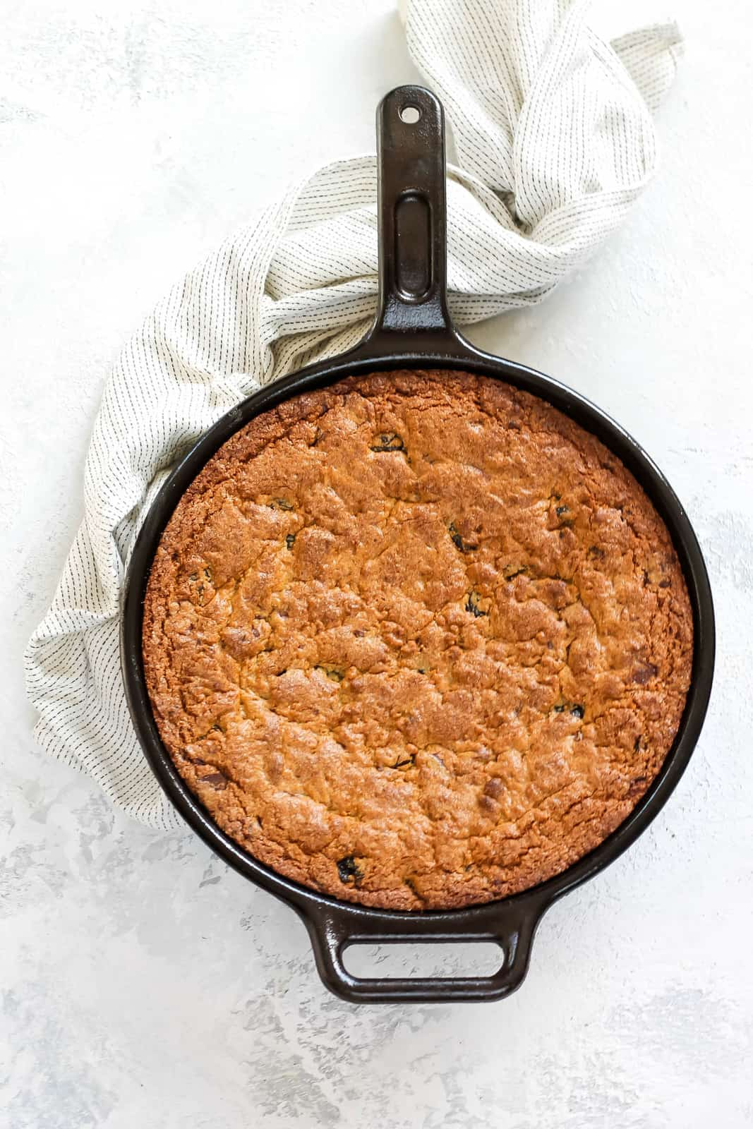 overhead photo of a spelt flour cast iron skillet cookie still in the skillet
