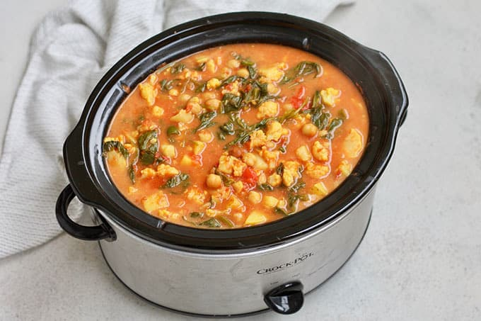 overhead photo of chickpea vegetable curry in a slow cooker