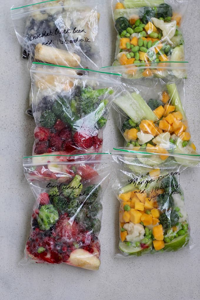 portrait shot of freezer bags packed with fruits and vegetables to make smoothies